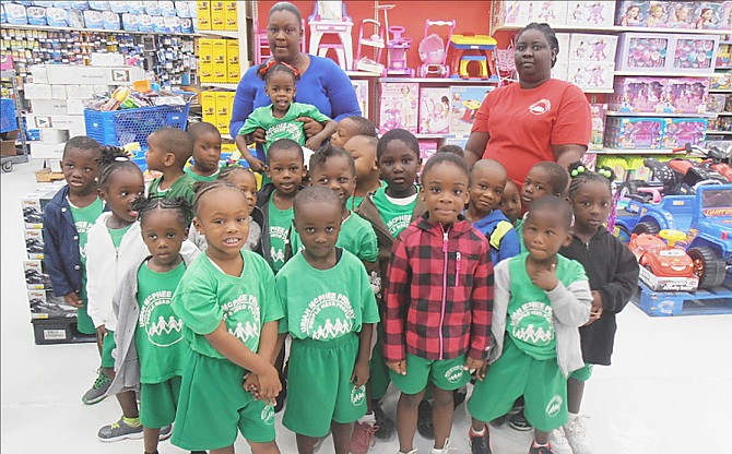 Students of Uriah McPhee Primary School tour Solomon's Super Centre to learn about community builders and teamwork.