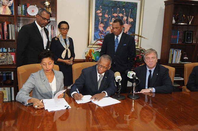 Seated, from left, Candia Ferguson, Cabinet secretary Wendall Major and Pierfrancesco Vago, executive chairman of MSC. Standing are Jerome Fitzgerald MP, Attorney General Allyson Maynard-Gibson and Prime Minister Perry Christie. 
