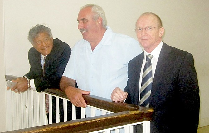 Bruno Rufa flanked by his lawyers Fred Smith QC (left) and Carey Leonard, of Callenders and Co, at an earlier hearing. Photo: Denise Maycock/Tribune Staff