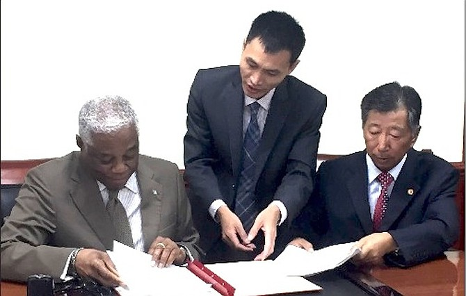 Dr Bernard Nottage accepts the donation of $1.2m from China to pay for military equipment.