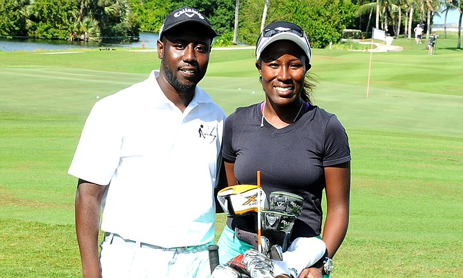 Georgette Rolle takes a photo with her Golf Caddy Ricardo Davis at the Pure Silk-Bahamas LPGA Classic at the Ocean Club Golf Course, Friday.  (BIS photo/Kemuel Stubbs)