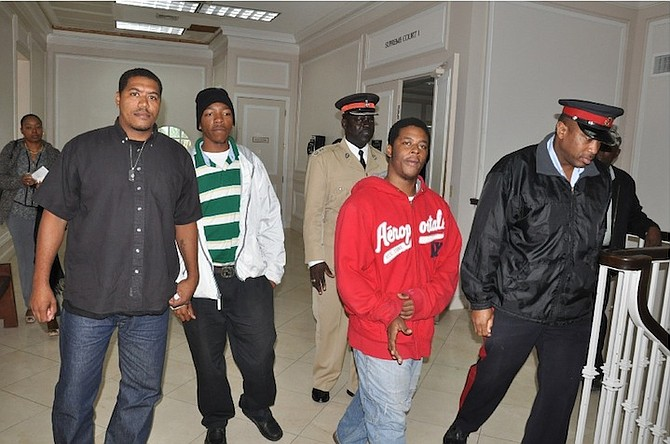 THE men walking free from court after being cleared.