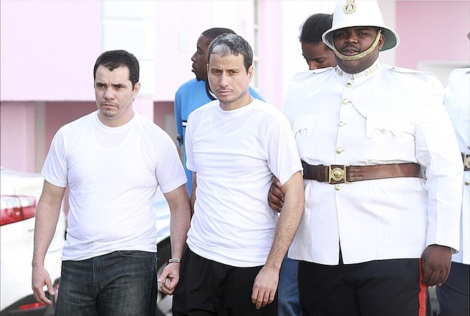 Cuban detainees Carlos Pupo and Lazaro Seara outside court. Photo: Tim Clarke/Tribune Staff