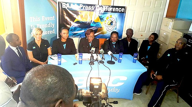 BAAA president Rosamude Carey, flanked by her executives, coaches and BTC sponsor, reveal plans for the 2016 BAAA track and field season during a press conference yesterday in the BAAA office at Thomas A Robinson Track and Field Stadium.                                                                                                                                                                               Photo by Philip Gray