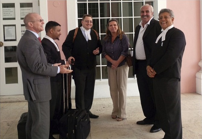 Bruno Rufa, second from right, and his lawyer Fred Smith, far right, outside court.
