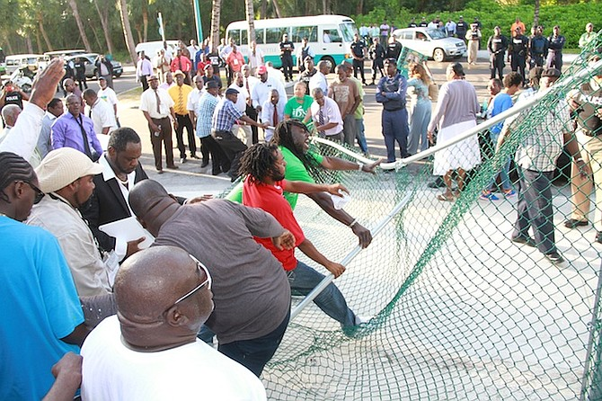 Vendors tear down the fence at the Cabbage Beach entrance point on Casino Drive.