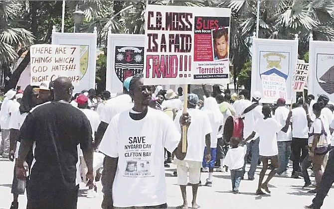 One of the pictures posted to Facebook of the Nygard support march in July 2013 showing a protestor holding a sign making accusations against CB Moss.