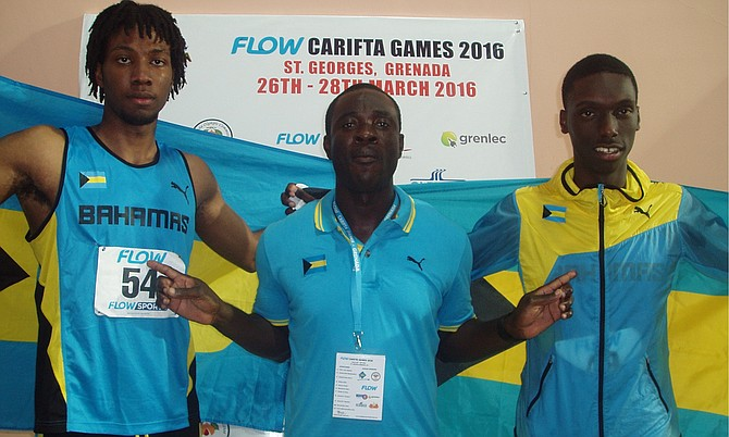 Gold medalist Jyles Etienne and bronze medallist Bejamin Clarke share a moment with coach James Rolle.