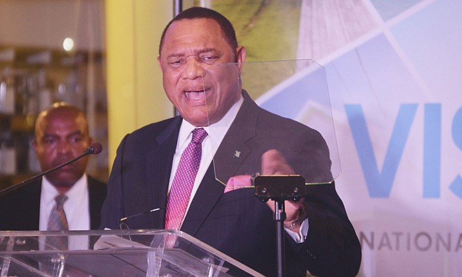 Prime Minister Perry Christie speaking at the unveiling of the National Development Plan last night at the College of The Bahamas. Photo: Shawn Hanna/Tribune Staff
