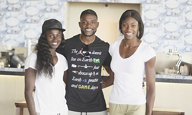 TOUCHING DOWN IN PARADISE: Bahamian quartermiler Shaunae Miller heads a list of world- class athletes who arrived at the Lynden Pindling International Airport yesterday to compete in the 2nd Chris Brown Bahamas Invitational, scheduled to be held on Saturday at the Thomas A Robinson National Stadium. Shown (l-r) at the airport are Tori Bowie, Justin Gatlin and our very own Miller.            Photo by Shawn Hanna/Tribune Staff