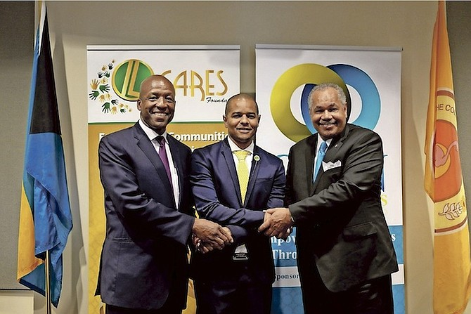 From left, Alfred Sears, College of The Bahamas council chairman; Sebas Bastian, CEO of Island Luck, and Rodney Smith, president and chief executive officer of the College of the Bahamas, at yesterday's announcement.  Photo: Shawn Hanna/Tribune staff