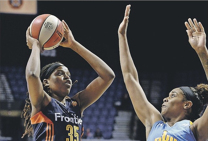 Connecticut Sun's Jonquel Jones, left, shoots as Chicago Sky's Cheyenne Parker, right, defends in the first half of last night's WNBA game in Uncasville, Connecticut. (AP Photo/Jessica Hill)