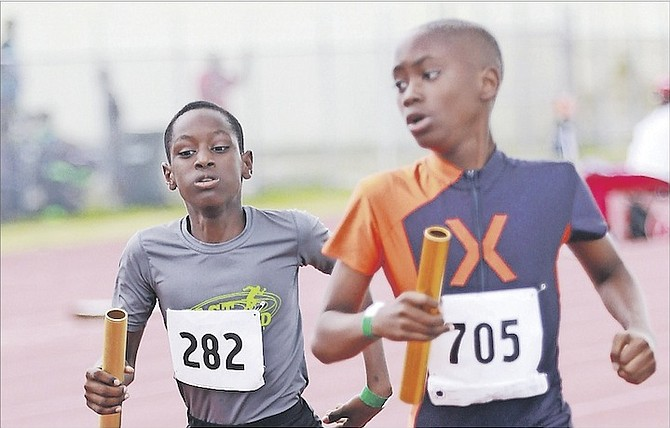 IN THE FAST LANE: Athletes compete in the Ambassadors Track Club's 9th Fritz Grant Track & Field Classic at the Thomas A Robinson Track and Field Stadium over the weekend.                         Photo by Tim Clarke/Tribune Staff