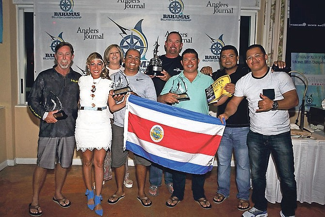 WINNING TEAM: The winning Uno Mas team celebrates victory in the Boat Harbour Championship at Abaco Beach Resort.