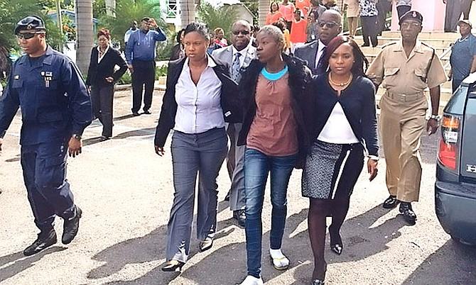 Raquel Johnson (brown shirt) outside of court.