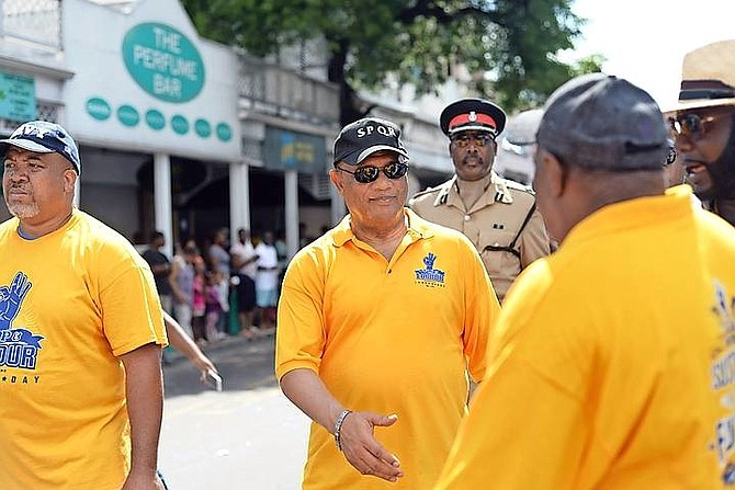 Prime Minister Perry Christie taking part in the Labour Day parade through downtown Nassau. 