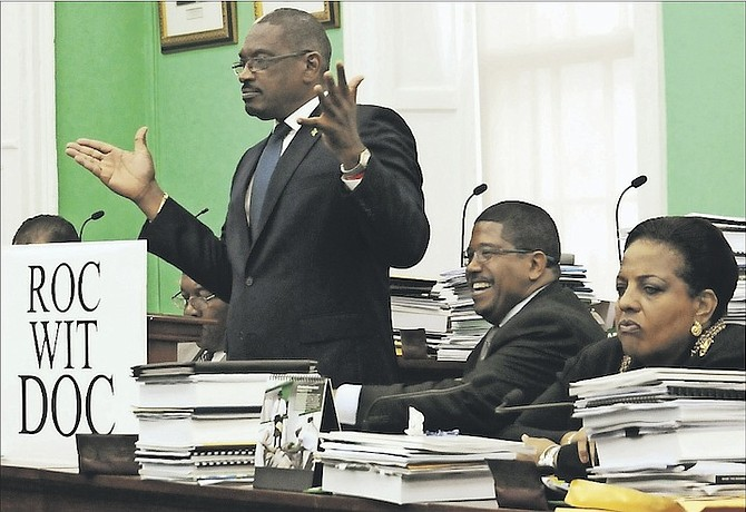 FNM leader Dr Hubert Minnis unveiling his 'Roc Wit Doc' slogan in the House of Assembly, pictured with deputy leader Peter Turnquest and Loretta Butler-Turner, who is to challenge for the leadership at the upcoming convention. Photo: Yontalay Bowe