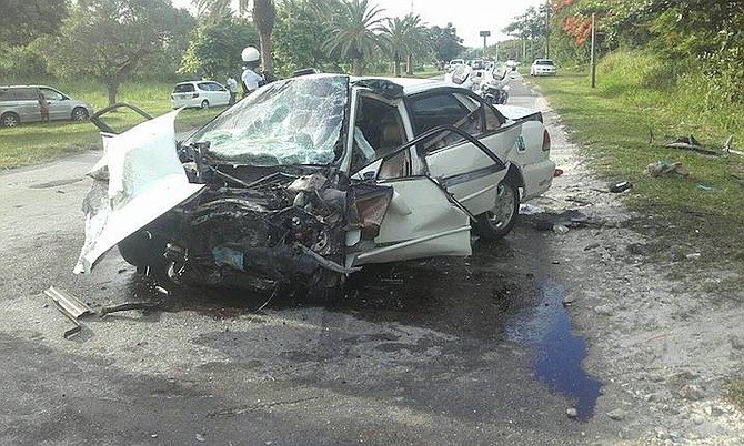 The extensively damaged Honda Accord which was involved in a head-on collision on Tonique Williams Darling Highway on Thursday morning