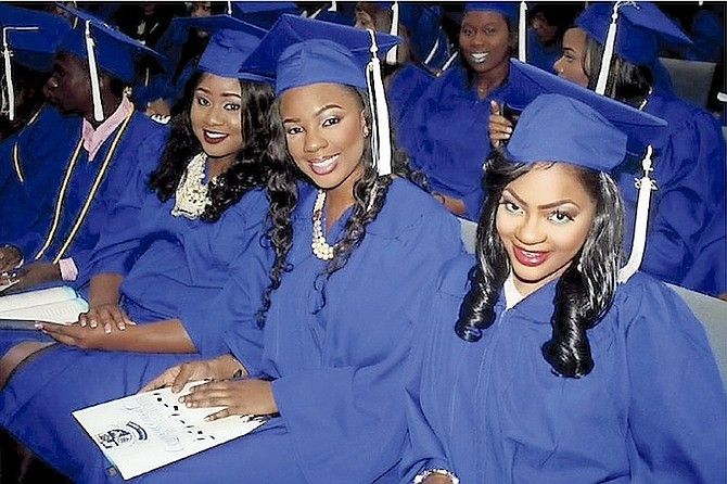 Graduates are all smiles in their caps and gowns. Photos: Shantique Longley