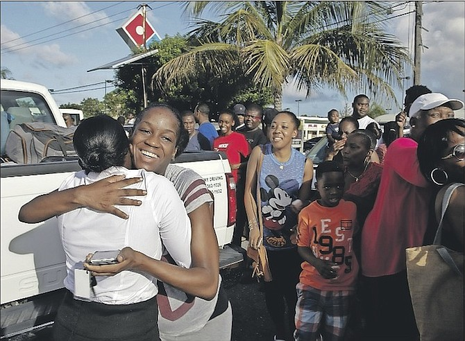 A Royal Bahamas Defence Force recruit embracing her loved one at the Golden Gates Shopping Plaza before entering training. Photo: Able Seaman Huden Johnson/RBDF