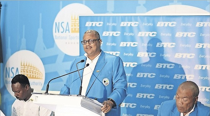 BAHAMAS Olympic Committee secretary general Romel Knowles (centre) releases the names of the 28 athletes who will represent the Bahamas at the Rio Olympics August 5-21. BOC President Wellington Miller (far right) and Minister of Youth, Sports & Culture Dr Daniel Johnson (left) look on during the press conference yesterday.