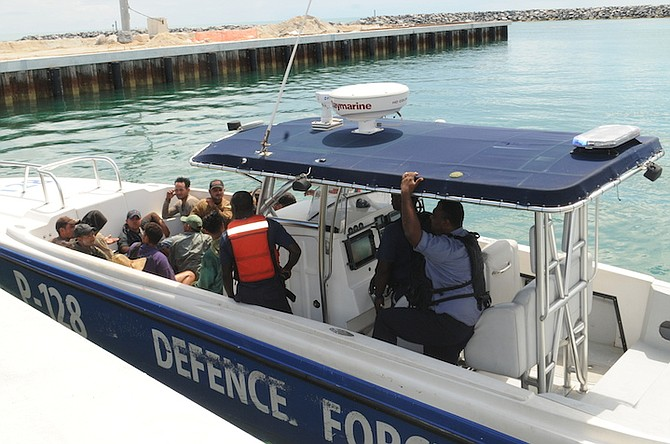 The 14 Cuban migrants arrive at Coral Harbour Base aboard Defence Force patrol craft P-128 on Saturday afternoon. Photo: Petty Officer Jonathan Rolle/RBDF