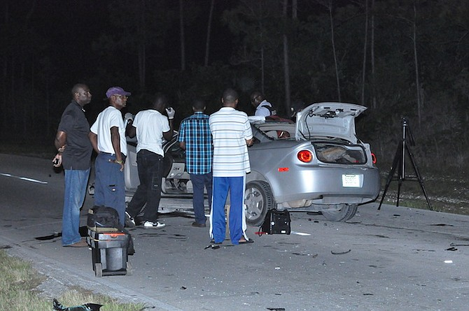 Officers at the scene of the fatal crash on East Sunrise Highway on Monday night in which a 19-year-old Holmes Rock man died. Photo: Vandyke Hepburn/BIS