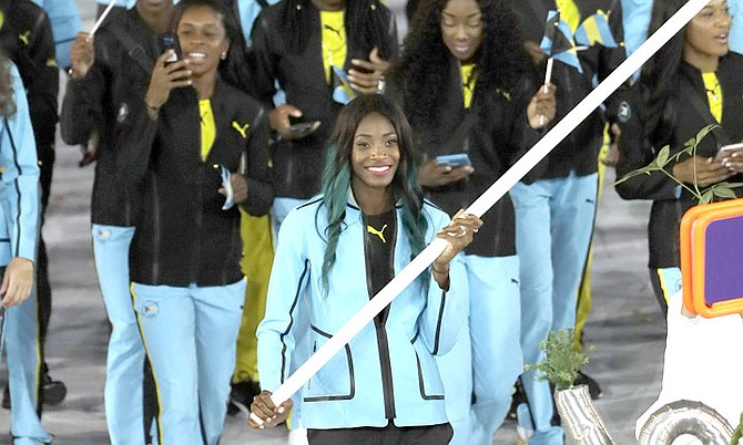 Shaunae Miller carries the Bahamas flag during the opening ceremony of the 2016 Summer Olympics in Rio de Janeiro, Brazil. (AP Photo/Matt Slocum)