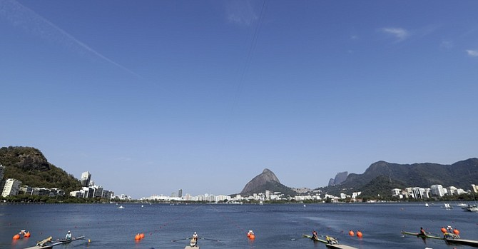 Rowers compete in the Women's single sculls heats in Lagoa. (AP)