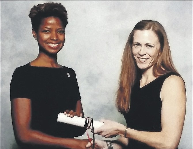 Dr DeVonnia Bonimy-Lee (left) receives her certification at the American Physical Therapy Association's recognition ceremony in California in February this year.