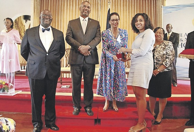Simone Cambridge receiving her award for being this year's All Bahamas Merit Scholar from Governor General Dame Marguerite Pindling. Photo: Tim Clarke/Tribune Staff