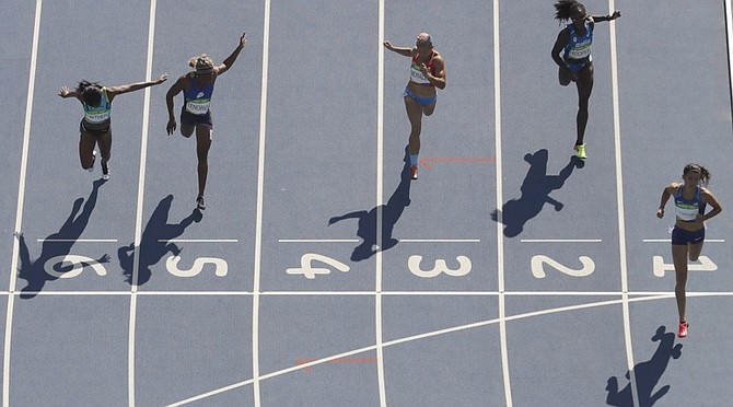 Tynia Gaither (left) finishes third to qualify for the 200m semifinals. (AP)