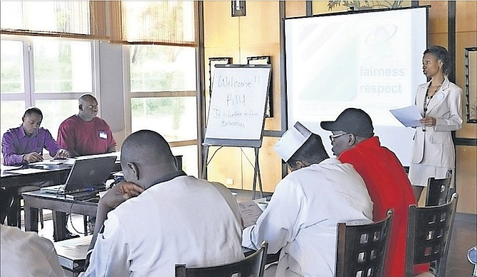 Bahamas Family Planning consultant Lowena West (far right) facilitates a workshop.