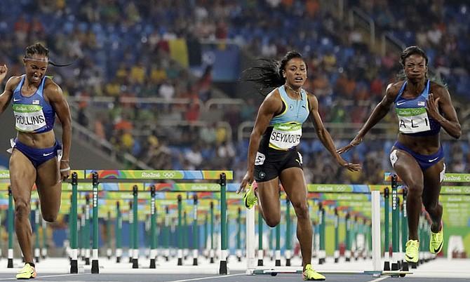 Pedrya Seymour (centre) in the 400m hurdles final. (AP)