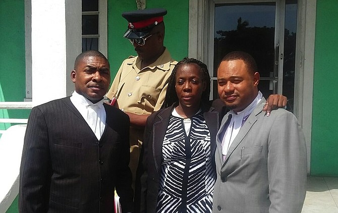 Maria Daxon with her legal representatives Wilver Deleveaux and Glendon Rolle outside the Central Police Station on Friday