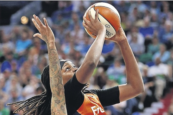Connecticut Sun's Jonquel Jones, of the Bahamas, goes for a basket after being fouled by Minnesota Lynx's Seimone Augustus (33) during the first half of Sunday's WNBA game in Minneapolis. 