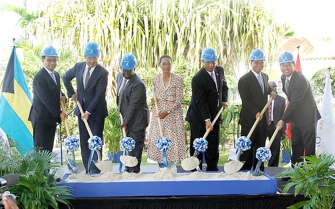 Standing side by side: The Government and the Chinese are threatening to squeeze Bahamian creditors over Baha Mar.