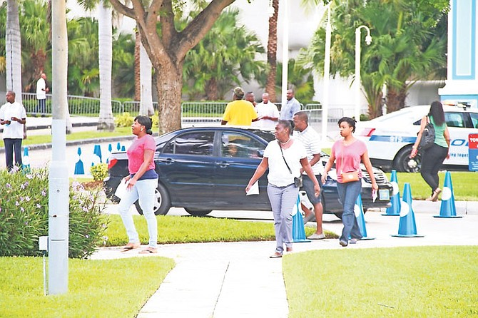 The scene at Baha Mar yesterday as former workers arrived to collect salary they were owed.