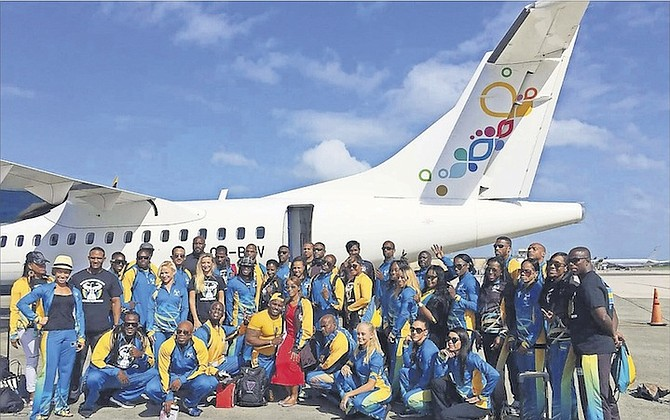 Officials and team members for the Bahamas bodybuilding team pose above outside of the chartered Bahamasair flight that took the team to Santo Domingo, Dominican Repulbic, for the 2016 CAC Bodybuilding and Fitness Championships this weekend.