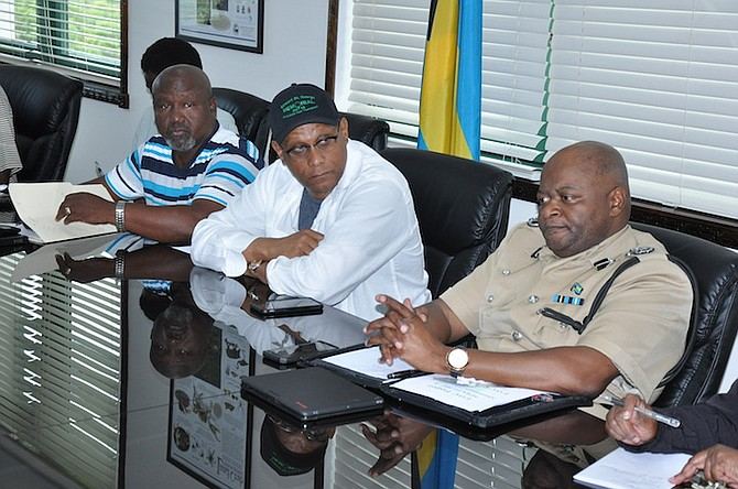 Dr Michael Darville, Minister for Grand Bahama (centre), at the emergency management meeting after which evacuation orders were issued for the island. Photo: Vandyke Hepburn/BIS