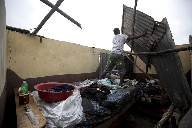 A resident repairs his home destroyed by Hurricane Matthew in Les Cayes, Haiti, on Thursday. Photo:Dieu Nalio Chery/AP