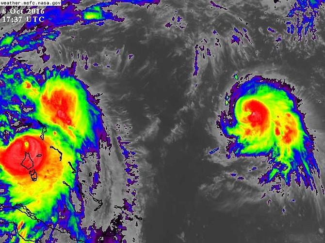 Hurricane Nicole (far right), the sixth hurricane of the Atlantic season, was more than 700 miles east of Hurricane Matthew (far left) at 1.37pm. Photo: NASA/MSFC Earth Science Office.