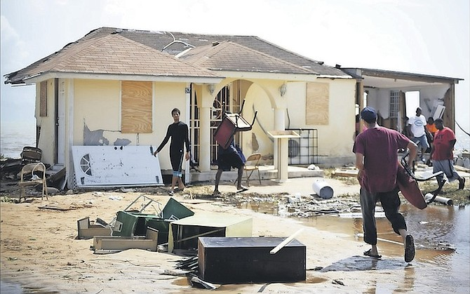 People move in to clear up at the United Fellowship Outreach Ministries International on South Beach Road, which was among many properties hit hard by Hurricane Matthew. 