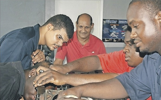 Students at an auto mechanics class at the Bahamas Technical and Vocational Institute.