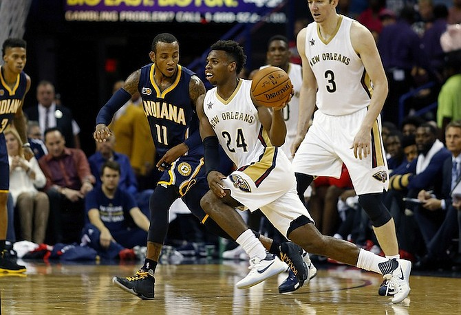New Orleans Pelicans guard Buddy Hield (24) dribbles past Indiana Pacers guard Monta Ellis (11) during the first half of an NBA preseason basketball game in New Orleans, La., earlier this month. (AP)