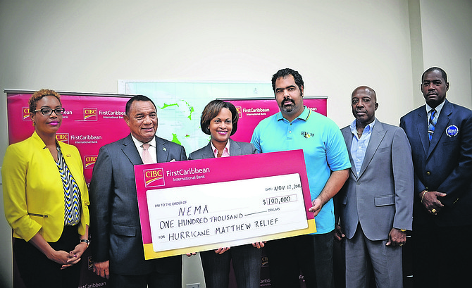 CIBC FirstCaribbean Managing Director Marie Rodland-Allen presents a $100,000 cheque to NEMA for post Hurricane Matthew relief and restoration work to Prime Minister Perry Christie and Gowon Bowe, member of the disaster relief committee responsible for the accounting and fund raising. Also pictured are Maya Nottage, CIBC FC Marketing and PR Manager (left); Shane Gibson, Minister responsible for Recovery and Restoration and Captain Stephen Russell, Director, NEMA. Photo: Shawn Hanna/The Tribune