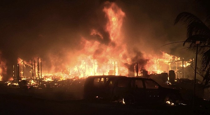 The massive fire destroyed four homes.