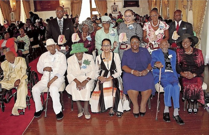 Governor General Dame Marguerite Pindling (fourth from right) and Minister of Social Services and Community Development Melanie Griffin pose for a photograph with those being honoured or their representatives at the Nation Builders Award Ceremony. Photo: Patrick Hanna/BIS