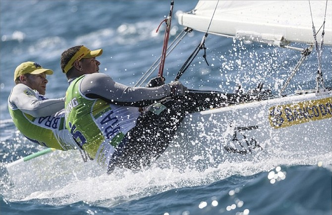 ROBERT SCHEIDT and Henry Boening, of Brazil, in action yesterday in the qualifying rounds of the Star Sailors League Finals in Montagu Bay, Nassau.