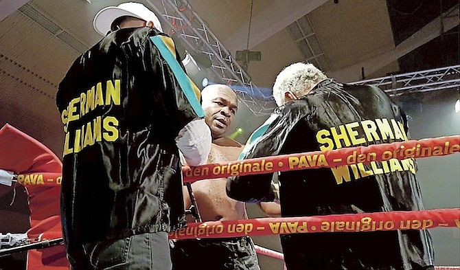SHERMAN WILLIAMS assisted in his corner during the fight.